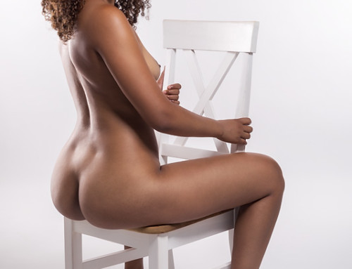 Black nude on a white chair
